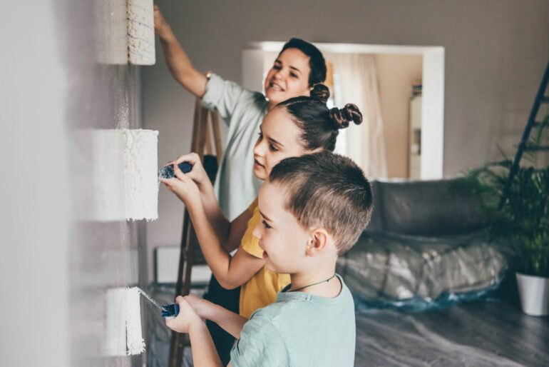 a family painting their house before selling