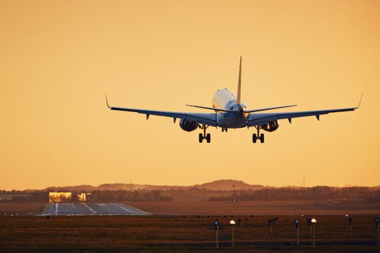 an airplane approaching a runway to land
