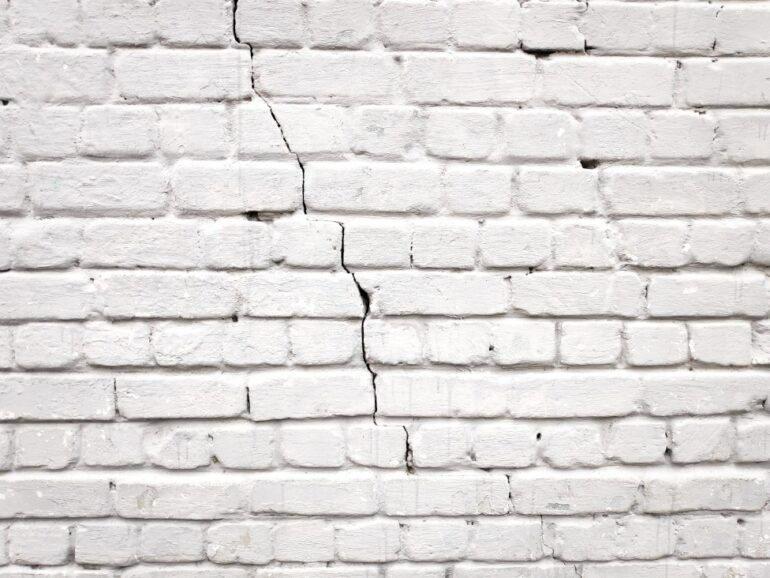 a cracked brick wall due to foundation problems
