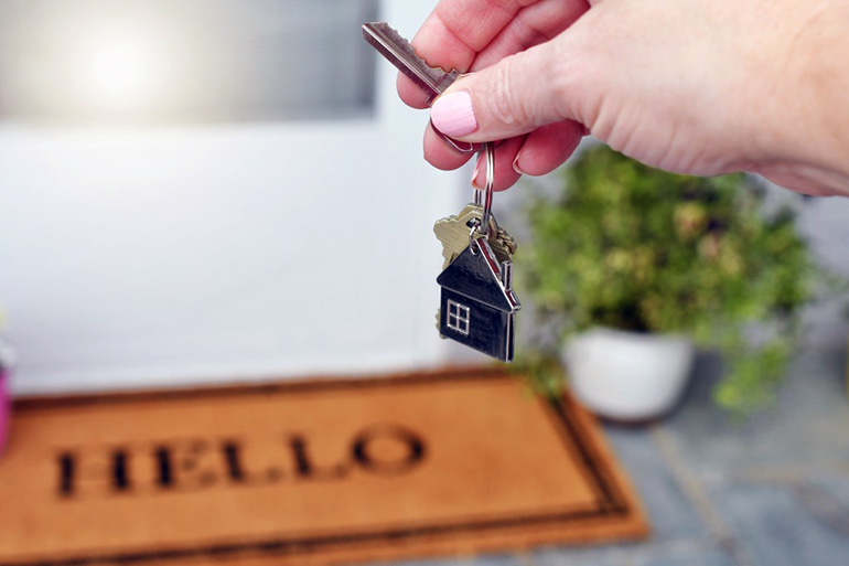 a female holding the keys of her newly inherited house