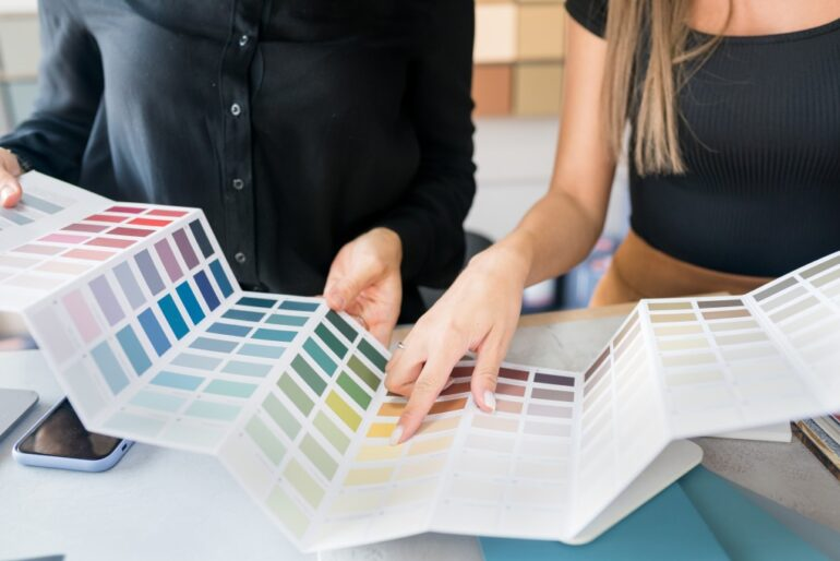 a homeowner and interior designer selecting paint colors