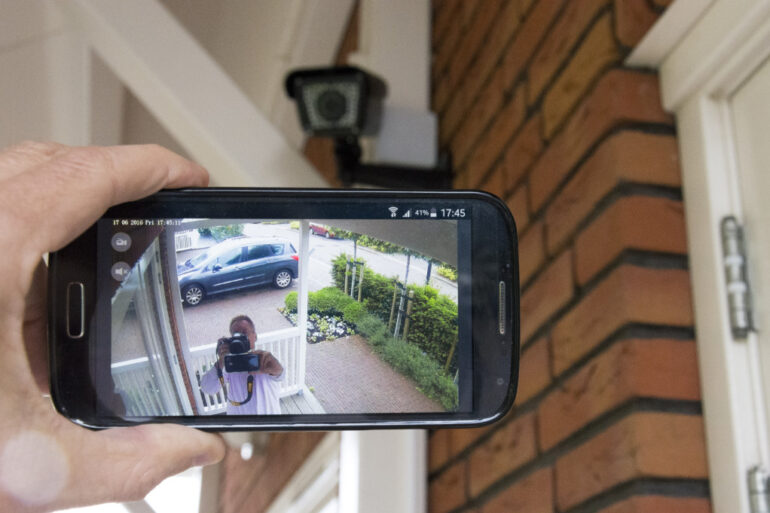 homeowner checking a wireless home security system