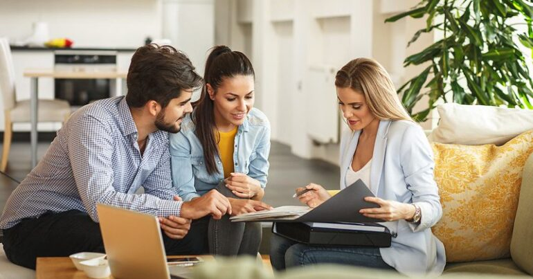 realtor discussing commissions and fees with clients