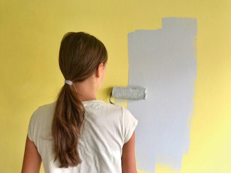 woman painting her bedroom walls